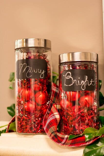 Chalkboard canisters filled with ornaments and tinsel | RichsHome.com